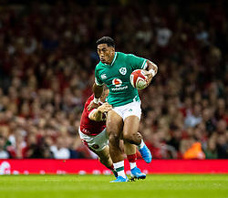 Bundee Aki of Ireland under pressure from Steff Evans of Wales<br /> <br /> Photographer Simon King/Replay Images<br /> <br /> Friendly - Wales v Ireland - Saturday 31st August 2019 - Principality Stadium - Cardiff<br /> <br /> World Copyright © Replay Images . All rights reserved. info@replayimages.co.uk - http://replayimages.co.uk