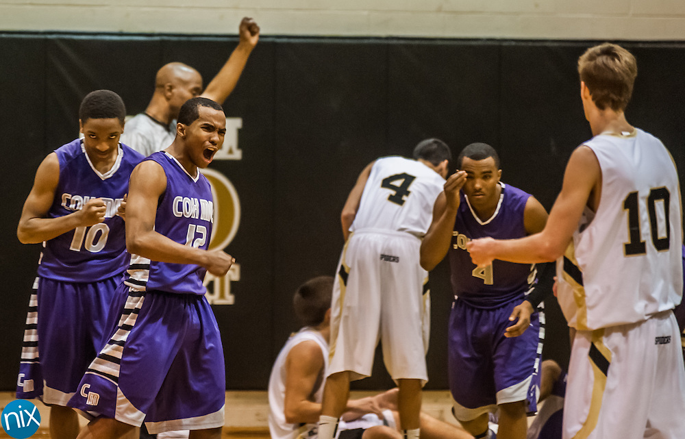 Cox Mill against Concord Tuesday night during the semi-finals of the South Piedmont Conference Tournament at Concord High School. The Chargers defeated No.1 ranked Concord 90-85 in overtime to advance to the finals against A.L. Brown