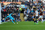 Son Heung-Min of Tottenham Hotspur puts the ball past Burnley Goalkeeper Thomas Heaton to score his teams 2nd goal. Premier League match, Burnley v Tottenham Hotspur at Turf Moor in Burnley , Lancs on Saturday 1st April 2017.<br /> pic by Chris Stading, Andrew Orchard sports photography.