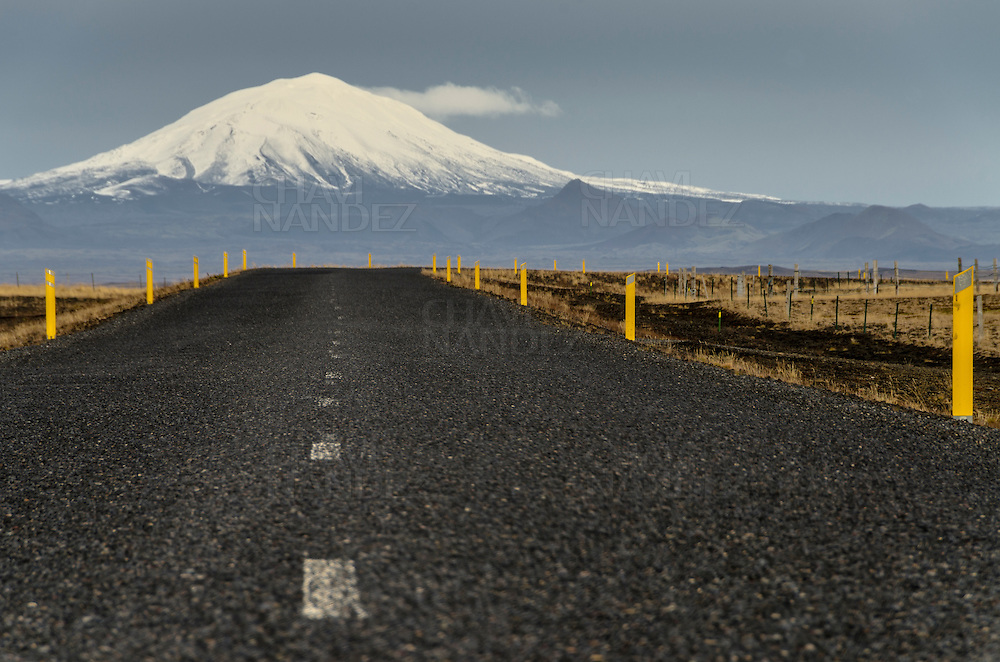 Road with Hekla volcano background. Iceland