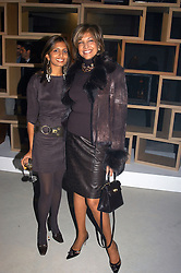 Left to right, MISS DIVIA LALVANI and her mother MRS VIMLA LALVANI at an exhibition of work by Rolf Sachs - a unique world-renowned contemporary furniture designer, held in association with the Louisa Guinness Gallery and held at 250 Brompron Road, London on 6th October 2004.<br />