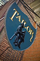 Hand carved tailor shop store sign.