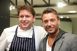 © London News Pictures. 12/04/2012. James Martin and Gino D'Acampo. Photocall at the opening of the BBC Good Food Show at Glow Bluewater, Kent Picture credit should read Manu Palomeque/LNP