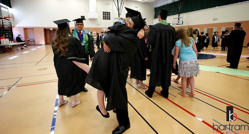 Mark Zelaya hugs his girlfriend Rebecca Cannon before Dozier-Libbey Medical High School graduation on Friday, June 8, 2012.  (Photo by Kevin Bartram)