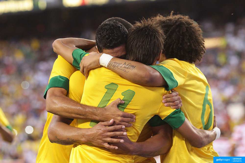 Neymar, Brazil, celebrates with team mates after scoring from the penalty spot during the USA V Brazil International friendly soccer match at FedEx Field, Washington DC, USA. 30th May 2012. Photo Tim Clayton