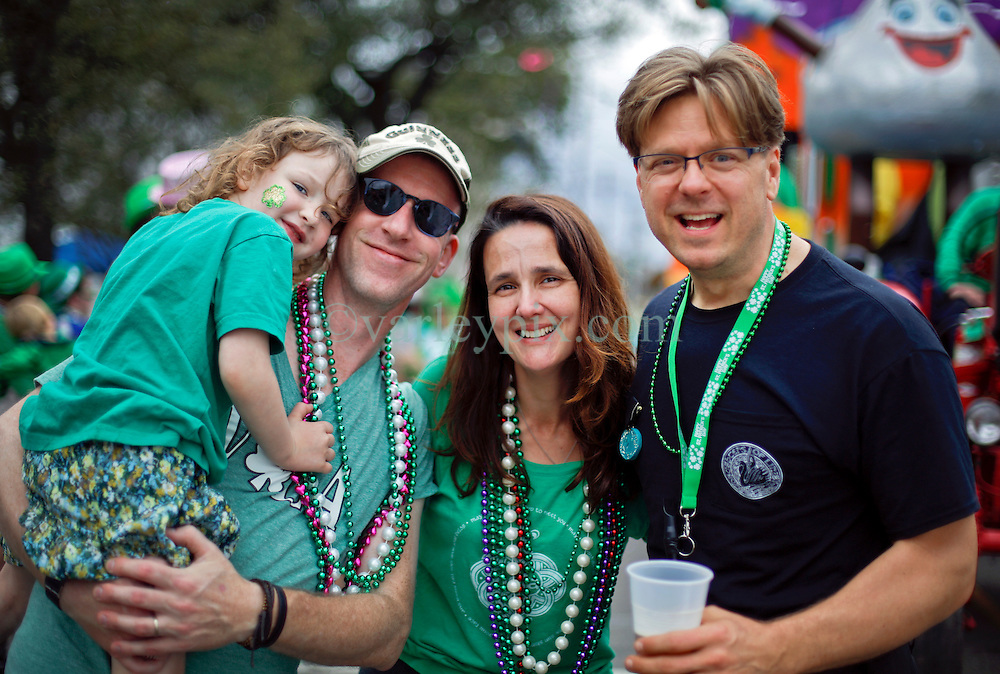 12 March 2016. New Orleans, Louisiana.<br /> Paul Ribka, Michael Depp, Darleen Mipro and daughter Aude at the Irish Channel St Patrick's Day parade as the procession makes its way along Magazine Street.<br /> Photo©; Charlie Varley/varleypix.com