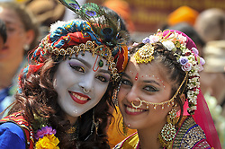 June 18, 2017 - London, UK - London, UK. Girls dressed as (L to R) Lord Krishna and consort Radha at the head of the parade.  Devotees celebrate the annual Rathayatra festival (''cart festival''), in central London.  Hare Krishna followers towed three huge decorated carts from Hyde Park corner to Trafalgar Square, singing and dancing all the way. (Credit Image: © Stephen Chung/London News Pictures via ZUMA Wire)