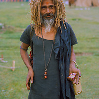 A Hindu ascetic (sadhu) smokes a bidi cigarette while on a pilgrimage to Amarnath Cave in the Great Himalaya Range of Kashmir, India.