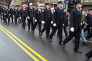 Police officers from across the US and Canada march in formation at the funeral for officer Wenjian Liu, a son of Chinese immigrants, who was killed with his partner Rafael Ramos on  December 20th, in Dyker Heights, Brooklyn, New York.
