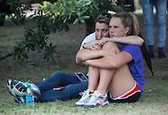 Mourners at a vigil for Baton Rouge Police Officers Montrell Jackson, Matthew Gerald and East Baton Rouge Parish Sheriff Deputy Brad Garafola at Louisiana State University on July 20, 2016 in Baton Rouge, Louisiana.