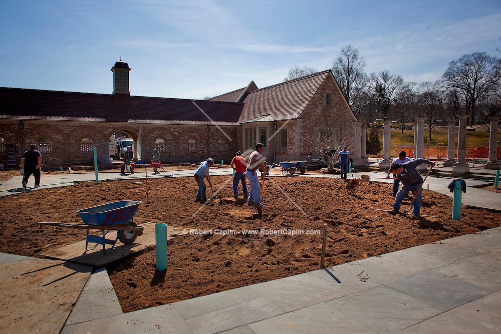 Workers complete landscaping at Steven Schonfeld's newly built $90 million home in Long Island, NY on Thursday, March 26, 2009.