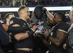 December 23, 2017 - Fort Worth, TX, USA - The Army Black Knights celebrate a 42-35 win against the San Diego State Aztecs on Saturday, Dec. 23, 2017, in the Armed Forces Bowl at Amon Carter Stadium in Fort Worth, Texas. (Credit Image: © Steve Nurenberg/TNS via ZUMA Wire)