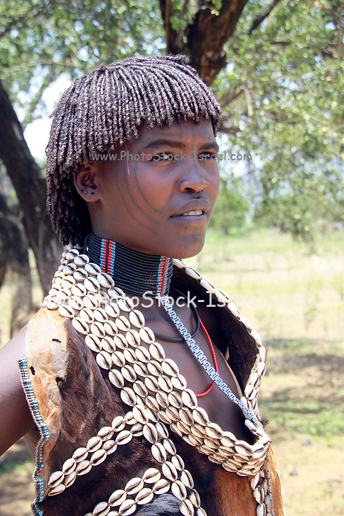 Africa, Ethiopia, Debub Omo Zone, Tsamai tribeswomen. (Also Tsemai) An agricultural and cattle herder ethnic group located in Southwestern Ethiopia, Woman wearing traditional leather clothing and shell necklace