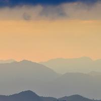 View of the rolling mountain peaks of Kaeng Krachan National Park at daw. Kaeng Krachan is Thailand's largest National Park.