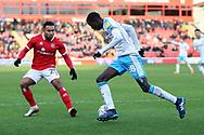 Panutche Camara runs at Wes McDonald during the EFL Sky Bet League 2 match between Walsall and Crawley Town at the Banks's Stadium, Walsall, England on 18 January 2020.