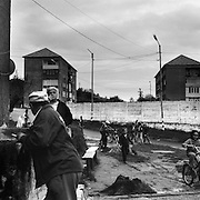 A scene from a housing estate in the heart of the small Romanian town of Copsa Mica, Transylvania, Romania. Copsa Mica was once described as the most polluted town in Europe. May 8, 2008. Photo Tim Clayton...Copsa Mica, a small industrial town deep in Transylvania, Romania, was described during the 1990s as the most polluted town in Europe with lead levels reaching were more than 1000 times the allowable International limits and life expectancy nine years shorter than the National average...The pollution was caused entirely by two factories, Carbosin produced black for dies and tires and closed in 1993 while Sometra, a nonferrous smelter is still operational today...The pollution was so bad sheep were black, covered in soot and health officials advised against eating livestock or vegetables and drinking the water or milk...The Communist rule of Nicolae Ceausescu is blamed for the widespread environmental degradation that left industrial parts of Romania in ecological disaster. Industry was situated in a way to concentrate pollution in small areas leaving the rest of the country relatively free of pollution.Copsa Mica in particular was left an environmental disaster...The pollution caused a direct affect on human health with widespread Lung disease, Impotency, the highest infant mortality rate in Europe, Lead poisoning andbehavioral problems...Fifteen years on since the closure of Carbosin in 1993, the factory skeleton remains as part of the towns bleak landscape, Unfinished communist style housing blocks still stand in the heart of the towns housing estate. The town's inhabitants arestill trying to recover from the long lasting effects of pollution...Recent survey's found the soil contained so much lead that it was 92 times above the permitted level; the vegetation had a lead content 22 times above the permitted level. While toxins have penetrated at least one meter (three feet) into the soil leaving the entire food chain in the area contaminat