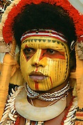 Woman in traditional costume with her face painted, Papua New Guinea