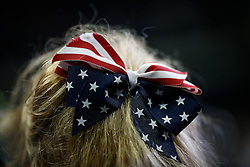 Feb. 12, 2016 - Tampa, Florida, U.S. - LOREN ELLIOTT   |   Times.Trump supporter Bernice Cochran of Lutz waits on the main floor before a Donald Trump rally during the business mogul's presidential campaign at the University of South Florida Sun Dome in Tampa, Fla., on Friday, Feb. 12, 2016. Trump is leading Florida polls for the Republican nomination. Cochran came to the event with her husband, Mike Cochran. (Credit Image: © Loren Elliott/Tampa Bay Times via ZUMA Wire)