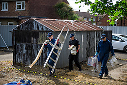 © Licensed to London News Pictures. 16/05/2017. London, UK. Belongings being carried from a shed, being dismantled by a search team, at the scene where police continue to search for the body of murdered schoolgirl Danielle Jones at a block of garages in Stifford Clays in Thurrock, Essex. The 15-year-old was last seen on Monday June 18 2001 at about 8am when she left her home in East Tilbury to catch the bus to school.  Photo credit: Ben Cawthra/LNP