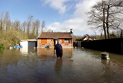 12 March 2020. Beaumerie St Martin, Pas de Calais, France.<br /> Monsieur Haegeman wades through floods outside his flooded house as the floodwaters continue to rise. Following months of record rainfalls, the Canche River near Montreuil Sur Mer burst its banks flooding local homes. The river last flooded in 2013, however residents claim they have never seen it as bad as this.<br /> Photo©; Charlie Varley/varleypix.com