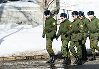 MOSCOW - CIRCA MARCH 2013: Military personnel walking inside the Kremlin in Moscow with people in the streets, circa 2013. With a population of more than 11 million people is one the largest cities in the world and a popular tourist destination.