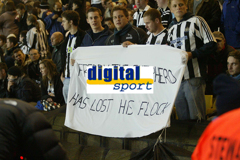 Photo: Marc Atkins.<br /> Watford v Newcastle United. Carling Cup. 07/11/2006.<br /> Newcastle United fans hold a banner to protest against Chairman Freddie Shepard.