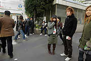 Japanese young adults standing around
