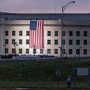 A man walks past the Pentagon, where a large flag is displayed in remembrance of the terror attacks 18 years ago today, on Wednesday, Sept. 11, 2019 in Arlington. (Staff Photo by Jay Westcott)