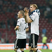 Germany's Per MERTESACKER (R) and  Bastian SCHWEINSTEIGER (L) during their UEFA EURO 2012 Qualifying round Group A matchday 19 soccer match Turkey betwen Germany at TT Arena in Istanbul October 7, 2011. Photo by TURKPIX
