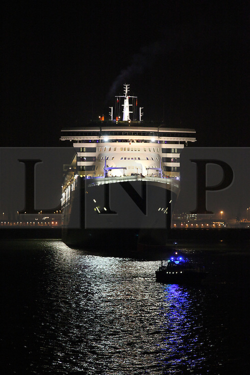 © Licensed to London News Pictures. 09/05/2014. Southampton, UK. Queen Mary 2 positioning herself on Southampton Water prior to a firework display. Firework celebrations marking the 10-year anniversary of the Cunard flagship, Queen Mary 2, take place in the port of Southampton this evening, 9th May 2014. All 'three queens' of the Cunard fleet were present at the event, which included a 10-minute firework display, one minute for every year that the QM2 has been in service. Photo credit : Rob Arnold/LNP