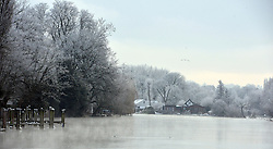 © Licensed to London News Pictures. 12/12/2012. Henley, UK Birds rest on the River Thames in Henley today. Frosty weather around Henley today 12 December 2012. Fog and ice has caused disruption around the country.  Photo credit : Stephen Simpson/LNP