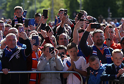 Rangers fans try to get a glimpse of the team as they arrive at Ibrox for the Ladbrokes Scottish Premiership match at Ibrox Stadium, Glasgow.