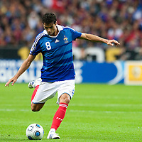 05 September 2009: French forward Yoann Gourcuff kicks the ball during the World Cup 2010 qualifying football match France vs. Romania (1-1), on September 5, 2009 at the Stade de France stadium in Saint-Denis, near Paris, France.