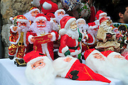 Israel, Haifa, Wadi Nisnas, Santa Claus figurines at the Holiday of holidays festival, celebrating Hanuka-Christmas-Ramadan December 2009