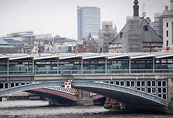 Tom Cruise (centre) walks along Blackfriars Bridge in London, during filming for Mission Impossible 6.