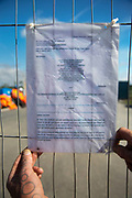 A legal penal notice at the entrance to Quadrillas drill site in New Preston Road, July 01 2017, Lancashire, United Kingdom. Any one found on Quadrillas land may be imprissoned or fined. Lancashire voted against permitting fracking but was over ruled by the conservative central Government. Fracking is a highly contested way of extracting gas, it is risky to extract and damaging to the environment and is banned in parts of Europe . Lancashire has in the past experienced earth quakes blamed on fracking.
