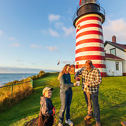 Visitors enjoy morning coffee at West Quoddy Head Lighthouse in Lubec, Maine.