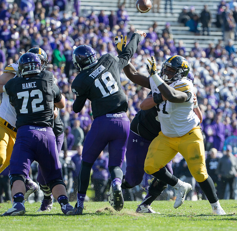 University of Iowa defensive lineman Darian Cooper (97) deflects Northwestern University quarterback Clayton Thorson's (18) pass during a NCAA Division I Football game between Northwestern University and the University of Iowa at Ryan Field on October 17, 2015 in Evanston, Illinois. (Dustin Satloff)