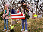 14 DECEMBER 2019 - DES MOINES, IOWA: Girl Scouts from Troop 93 place Christmas wreaths on veterans' graves. Volunteers working with Wreaths Across America placed Christmas wreaths on the headstones of more than 600 US military veterans in Woodland Cemetery in Des Moines. The cemetery, one of the first in Des Moines, has the graves of veterans going back to the War of 1812.      PHOTO BY JACK KURTZ