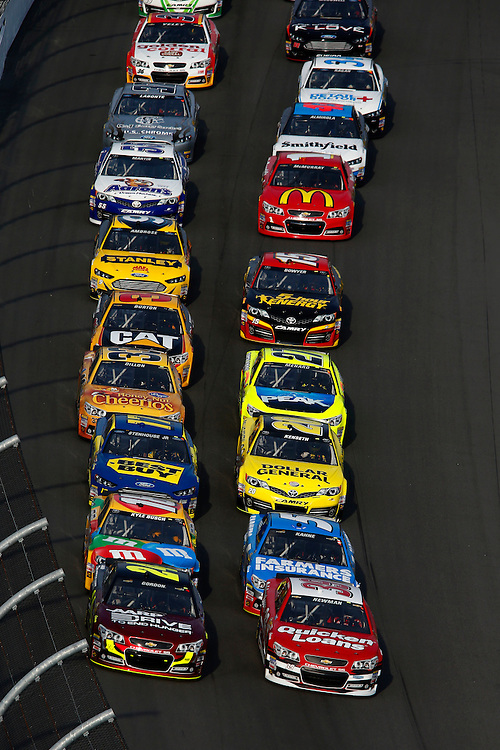 Feb 21, 2013; Daytona Beach, FL, USA; NASCAR Sprint Cup Series driver Jeff Gordon (24) leads the field to the green flag during race two of the Budweiser Duel at Daytona International Speedway. Mandatory Credit: Douglas Jones-DDJ Sports Imaging