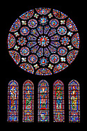 Medieval Rose  Window of the South Transept of the Gothic Cathedral of Chartres, France- Circa 1225-30. A UNESCO World Heritage Site. Dedicated to Christ, who is shown in the central oculus, right hand raised in benediction, surrounded by adoring angels. Two outer rings of twelve circles each contain the 24 Elders of the Apocalypse, crowned and carrying phials and musical instruments. The central lancet beneath the rose shows the Virgin carrying the infant Christ. Either side of this are four lancets showing the four evangelists sitting on the shoulders of four Prophets - a rare literal illustration of the theological principle that the New Testament builds upon the Old Testament. This window was a donation of the Mauclerc family, the Counts of Dreux-Bretagne, who are depicted with their arms in the bases of the lancets .<br /> <br /> Visit our MEDIEVAL ART PHOTO COLLECTIONS for more   photos  to download or buy as prints https://funkystock.photoshelter.com/gallery-collection/Medieval-Middle-Ages-Art-Artefacts-Antiquities-Pictures-Images-of/C0000YpKXiAHnG2k