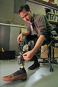 Robotic autonomous-control technology will become more and more useful to the disabled in the future, as Hugh Herr can testify. A double amputee, MIT Leg Lab researcher Herr is developing a robotic knee. Standard prosthetic joints cannot sense the forces acting on a human leg. But a robotic knee can sense and react to its environment, allowing amputees to walk through snow or on steep slopes now impassable for them. Cambridge, MA. From the book Robo sapiens: Evolution of a New Species, page 181.