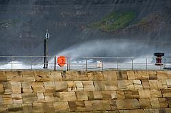 A high tide and high winds causes the rough sea to crash against Whitby coast and Whitby outer Harbor.September 2010 .Images © Paul David Drabble