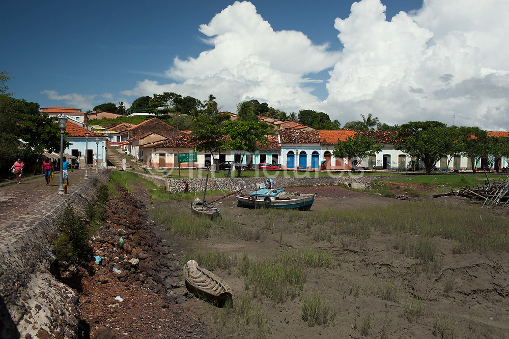 Boats sitting on a dried up riverbed in Alcantara on 27th May 2014, Maranhao, Brazil. It is an island off the north east coast of Brazil close to Sao Luis, state capital of, and is one of the largest Quilombos in Brazil, which are communities that were originally set up by escaped or freed slaves during the colonial period.