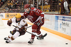 November 17, 2017 - Minneapolis, MN, USA - Minnesota's Mike Szmatula (9) and Harvard's Lewis Zerter-Gossage (77) battle for control of the puck in the first period on Friday, Nov. 17, 2017, at the 3M Arena at Mariucci in Minneapolis. (Credit Image: © Aaron Lavinsky/TNS via ZUMA Wire)