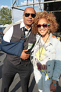 """June 2, 2012- Philadelphia, PA, United States: (L-R) Author/Writer Kevin Powell and Media Personality/DJ/Actress Amanda Seales attend the 5th Annual ROOTS Picnic held at Festival Pier at Penn's Landing in Philadelphia, PA . The Roots is an American hip hop/neo soul band formed in 1987 by Tariq """"Black Thought"""" Trotter and Ahmir """"Questlove"""" Thompson in Philadelphia, Pennsylvania. They are known for a jazzy, eclectic approach to hip hop which includes live instrumentals. (Photo by Terrence Jennings)"""