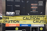 gas pump taped up with yellow caution tape