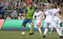 September 27, 2017 - Seattle, WASHINGTON, U.S - Soccer 2017: The Sounders CLINT DEMPSEY (2) takes a shot as the Vancouver Whitecaps visit the Seattle Sounders for an MLS match at Century Link Field in Seattle, WA. Seattle won the match 3-0. (Credit Image: © Jeff Halstead via ZUMA Wire)