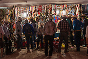Mexican cowboys shop for gear at a makeshift vendor set up as hundreds of cowboys camp along the road during the annual Cabalgata de Cristo Rey pilgrimage January 4, 2017 in La Sauceda, Guanajuato, Mexico. Thousands of Mexican cowboys and horse take part in the three-day ride to the mountaintop shrine of Cristo Rey stopping along the way at shrines and churches.