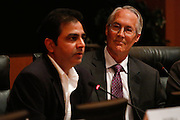 Rob Means listens to Rajeev Madnawat's response during the Milpitas City Council Forum at Milpitas City Hall in Milpitas, California, on October 9, 2014. (Stan Olszewski/SOSKIphoto)